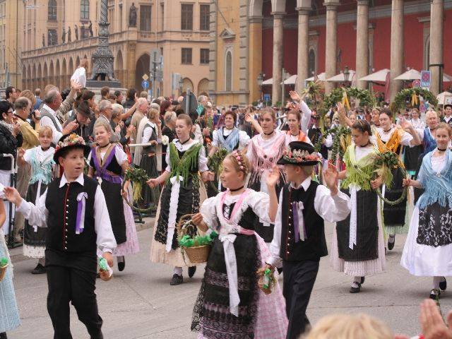 People doing traditional Bavarian dancing in the middle of Marienplatz.